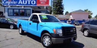 You can totally tell that a used truck for sale at Oakland, CA's Empire Auto Sales used to belong to energy giant PG&E.